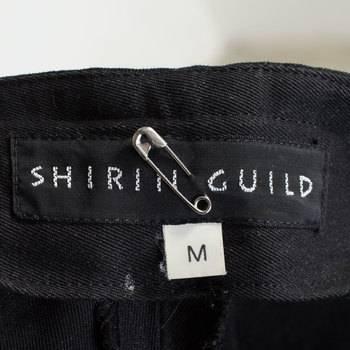 бирка Брюки  Shirin Guild